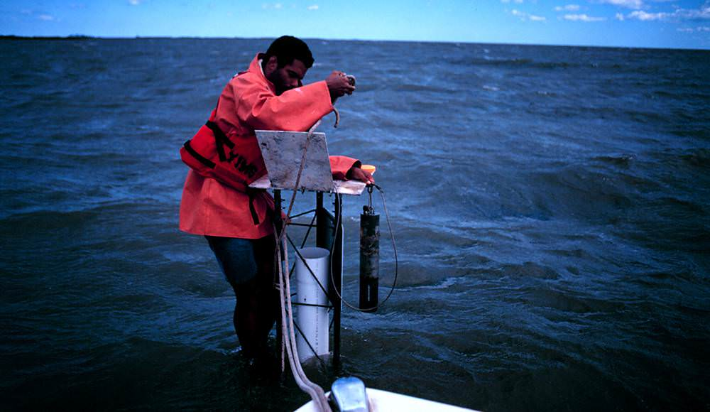 man standing on a offshore data-logger station